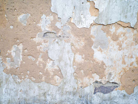 Damaged grey plastered wall next to new masoned stone wall, Old next to new, Renovation works, Building repairs. Stock Photo