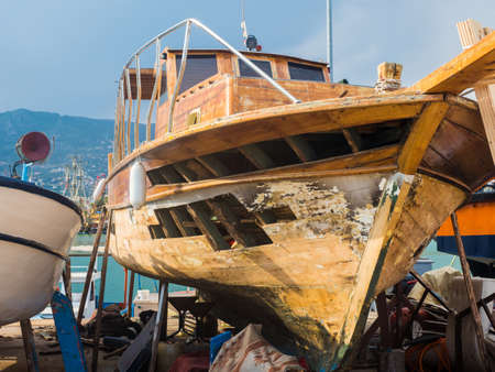the wooden boat at the shipyard is repaired after a breakdown