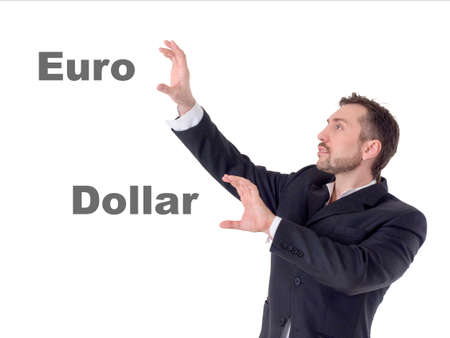 Businessman touching on air words euro and dollar 写真素材