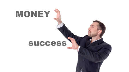 Businessman touching on air words money and success 写真素材 - 102026296