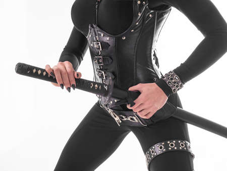 sexy female assassin body with sword, wearing black leather.