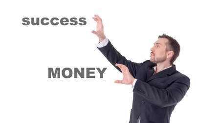 Businessman touching on air words money and success 写真素材