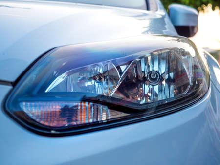 close up of car head light. Left headlamp of a car