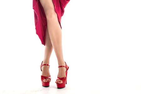 long toned legs in high-heeled shoes and red dress