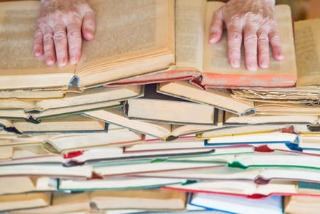 Never too old to learn - Hands of old woman reading book