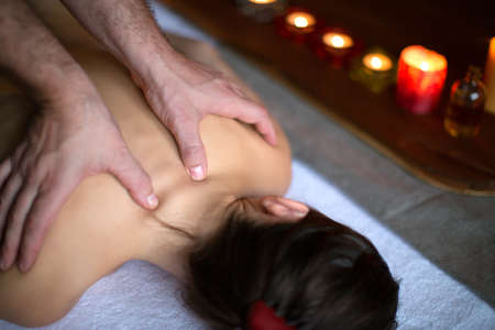 Close-up of a clients back being massaged