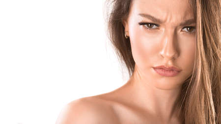 Close up portrait of a woman with an angry face. Looking mad and crazy shouting and making furious gestures. Isolated on white. Facial expressions and emotions.