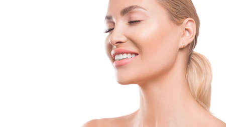 Smiling woman on white background. Dental and spa concept. Skincare
