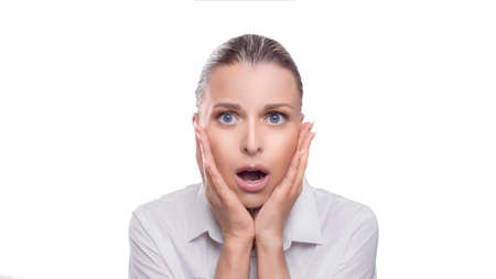 Portrait of a shocked woman isolated on white background