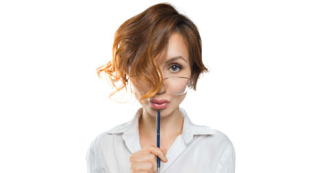 Funny looking teacher woman in eyeglasses looks into the camera. Teacher. Education concept.