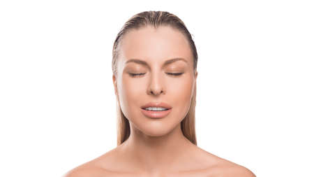 Young calm woman with closed eyes over white background. Plastic surgery, face lifting, skin care concept