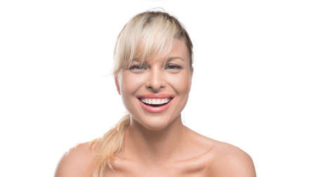 Happy smiling woman over white background looking at camera. Natural beauty, teeth and skin care concept