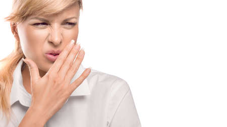 Beautiful Woman Covering Her Mouth and nose. Bad smell. Isolate on white background