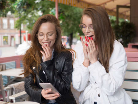 Excited girls got a good news from internet.