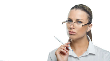 Pensive business woman in eyeglasses looks into the camera. Manager. Business concept.