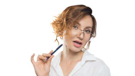 Pensive teacher woman in eyeglasses looks into the camera. Teacher. Education concept. 写真素材