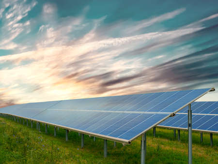 Green energy concept: solar panels in sunny day 写真素材