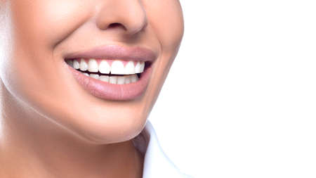 Teeth whitening concept - close up photo of a smiling woman.