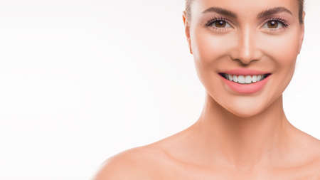 Smiling woman on white background. Skincare, dental and spa concept. 写真素材
