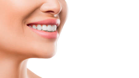 Close up photo of a woman smiling. Teeth whitening and health concept