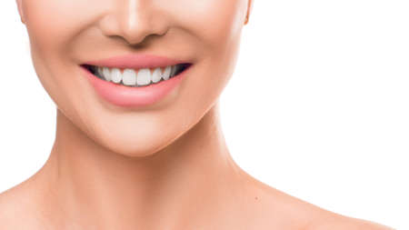Close up photo of a woman smiling. Teeth whitening and dental health.