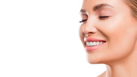 Close up portrait of a smiling woman. Reklamní fotografie