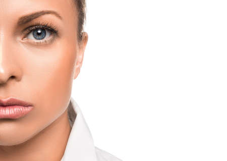 Close up portrait of a serious woman. Half of face and copy space.