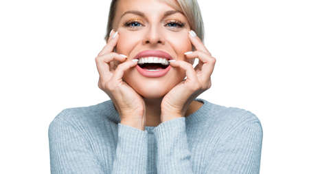 Laughing woman with great smile over white background. Dental health and teeth whitening concept. 写真素材