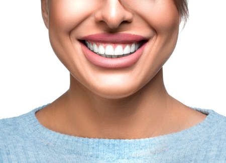Happy smiling woman with great white teeth over white background. Dental health concept. 写真素材