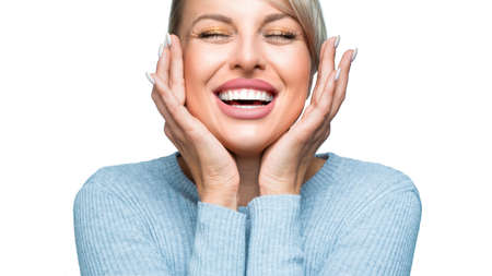 Laughing woman with great teeth over white background.
