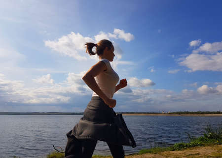 Woman jogging outdoor in summer tine. Healthy lyfestyle concept Stok Fotoğraf