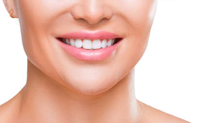 Womans smile with white healthy teeth, close up view - isolated on white background. Stok Fotoğraf