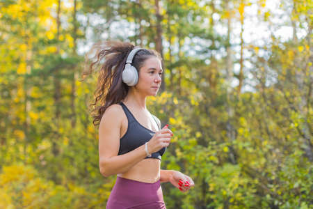 Woman jogging outdoor. Close up side portrait. Stok Fotoğraf