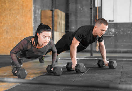Gym man and woman push-up. Strength pushup, Workout. Stok Fotoğraf