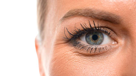 Close up view of an eye of a middle aged woman. Eyesight concept