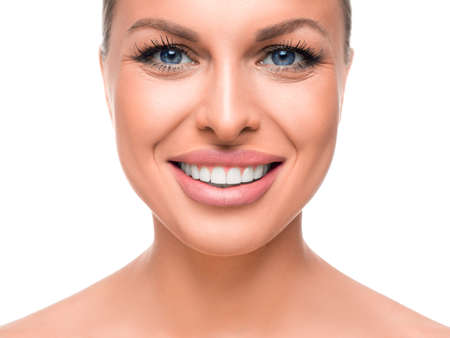 Smiling woman isolaed on white. Tooth whitening. Stok Fotoğraf