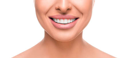 Close up photo of toothy smiling woman. Tooth whitening concept.
