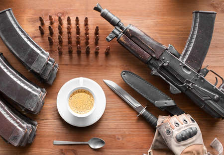 Breakfast of an arny soldier or terrorist. Coffe cup and ammo.