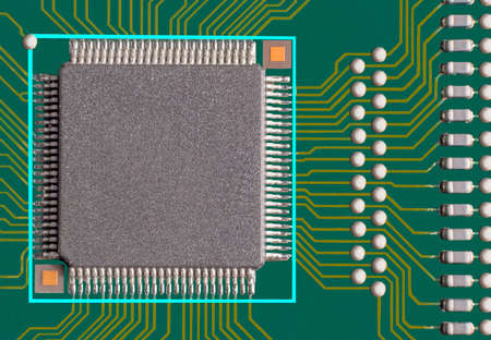 Electronic circuit board with processor, close up photo.