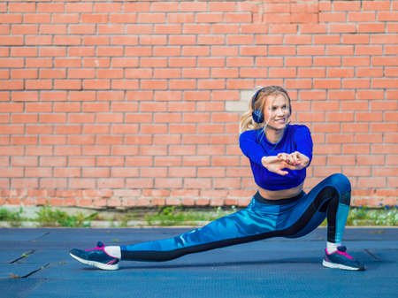 Young sportswoman stretching and preparing to run. Healthy lifestyle concept. Stok Fotoğraf