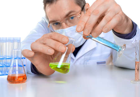 Male researcher carrying out scientific research in a lab.