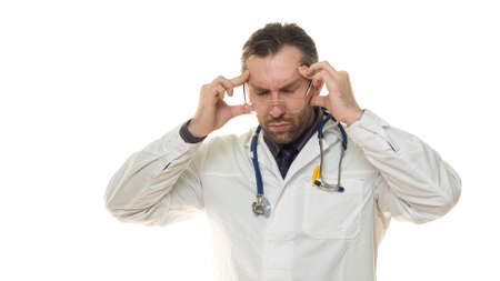 Male doctor hloding hands on his head. Headache and stress
