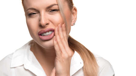 Young woman feel strong toothache. Photo on white background.