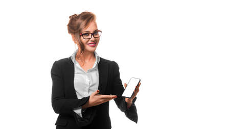 Business woman shows something on the screen of a mobile phone. Mock up.