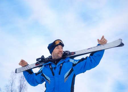 Smiling man with a ski make having rest before next downhill skiing. 版權商用圖片