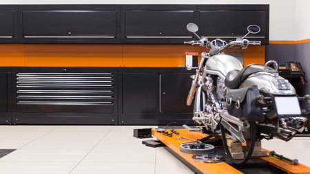 Photo of a motorcycle service garage. Workshop.