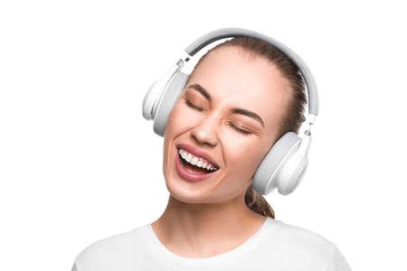 Singing woman in headphones.