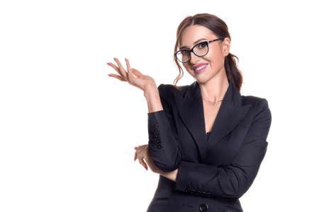 Smiley businesswoman in eyeglasses showing by hand on your product.