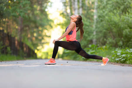 Woman stretching muscles outdoor. Sport and healthy lifestyle concept. Standard-Bild - 149469884