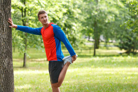 Sport and healthy lifestyle concept - jogger man stretcing muscles. Standard-Bild - 150068964